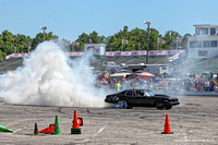 A car burns rubber during the burnout competition